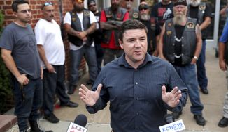 In a July 11, 2017, file photo, Jason Kessler speaks at a press conference with members of the Warlocks Motorcycle Club outside the Charlottesville Police Department in Charlottesville,, Va. Kessler, the chief organizer of a white nationalist rally in Virginia has been released on bond after being arrested on a perjury charge unrelated to the rally. Jason Kessler briefly appeared Wednesday, Oct. 4, 2017, in Albemarle County Circuit Court. A court clerk said he was released on bond.  (Ryan M. Kelly/The Daily Progress via AP)