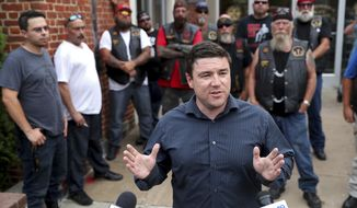 In a July 11, 2017, file photo, Jason Kessler speaks at a press conference with members of the Warlocks Motorcycle Club outside the Charlottesville Police Department in Charlottesville,, Va. (Ryan M. Kelly/The Daily Progress via AP)