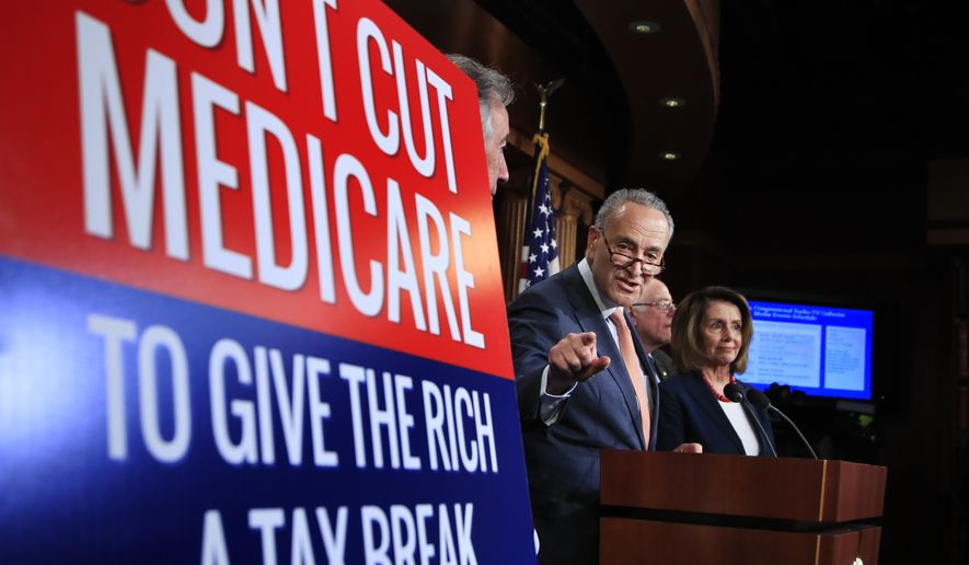 Senate Minority Leader Chuck Schumer of New York, with House Minority Leader Nancy Pelosi of Calif., right, and Sen. Bernie Sanders, I-Vt., back second from right, speaks during a news conference on Capitol Hill in Washington, Wednesday, Oct. 4, urging Republicans to abandon cuts to Medicare and Medicaid. (AP Photo/Manuel Balce Ceneta)