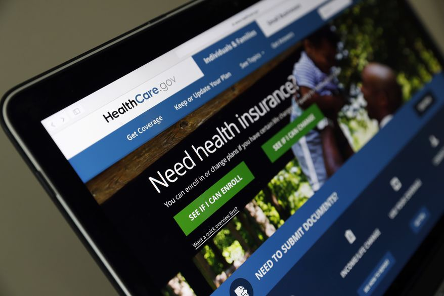 """In this May 18, 2017, file photo, the Healthcare.gov website is seen on a laptop computer, in Washington. Former Obama administration officials say they're launching a private campaign to encourage people to sign up for coverage next year under the Affordable Care Act. With the start of open enrollment just weeks away on Nov. 1, the Trump administration has slashed """"Obamacare's"""" ad budget, as well as grants to outside organizations that are supposed to help consumers sign up. (AP Photo/Alex Brandon, File)"""