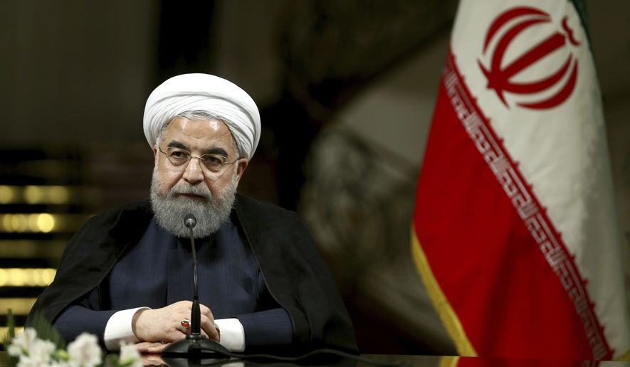 Iranian President Hassan Rouhani speaks with media during a joint press conference with Turkish President Recep Tayyip Erdogan after their meeting at the Saadabad Palace in Tehran, Iran, Wednesday, Oct. 4, 2017. (AP Photo/Ebrahim Noroozi) ** FILE **