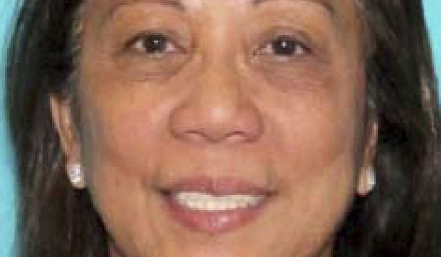 This undated photo provided by the Las Vegas Metropolitan Police Department shows Marilou Danley. Girlfriend of the active shooter in the Sunday, Oct. 1, 2017, incident, Danley, 62, returned to the United States from the Philippines on Tuesday night and was met at Los Angeles International Airport by FBI agents, according to a law enforcement official. (Las Vegas Metropolitan Police Department via AP)