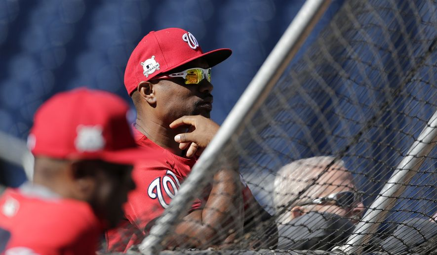 Washington Nationals' assistant hitting coach Jacque Jones watches batting practice during a baseball workout at Nationals Park, Wednesday, Oct. 4, 2017, in Washington. The Nationals host the Chicago Cubs in Game 1 of the National League Division Series on Friday. (AP Photo/Mark Tenally)