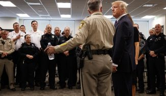 President Donald Trump listens to Clark County Sheriff Joseph Lombardo during a meeting with first responders at the Las Vegas Metropolitan Police Department, Wednesday, Oct. 4, 2017, in Las Vegas. (AP Photo/Evan Vucci)