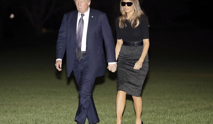 President Donald Trump and first lady Melania Trump walk across the South Lawn of the White House in Washington, Wednesday, Oct. 4, 2017, as they return from a trip to Las Vegas where they visited with victims and first responders affected by the worst mass shooting in American history. (AP Photo/Pablo Martinez Monsivais)