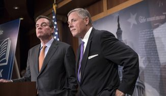 Sen. Richard Burr (right), North Carolina Republican and chairman of the Select Committee on Intelligence, and the committee's top Democrat, Sen. Mark R. Warner of Virginia, said months of investigation have not identified any collusion between Russia and Donald Trump's campaign, but the inquiry is continuing. (Associated Press) ** FILE **