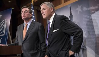 Sen. Richard Burr (right), North Carolina Republican and chairman of the Select Committee on Intelligence, and the committee's top Democrat, Sen. Mark R. Warner of Virginia, said months of investigation have not identified any collusion between Russia and Donald Trump's campaign, but the inquiry is continuing. (Associated Press)