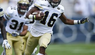 FILE - In this Sept. 23, 2017, file photo, Georgia Tech quarterback TaQuon Marshall (16) runs for a touchdown during the first half of an NCAA college football game against Pittsburgh, in Atlanta. Marshall and Clemson's Travis Etienne are two of the ACC's biggest surprises through the first month of the season. (AP Photo/Jon Barash)