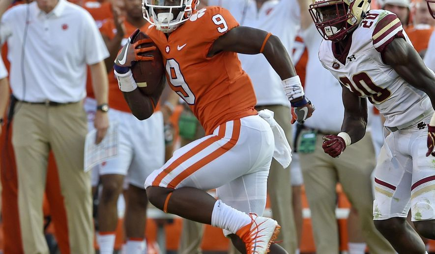 FILE - In this Sept. 23, 2017, file photo, Clemson's Travis Etienne outruns Boston College defenders to score a 50-yard touchdown during the second half of an NCAA college football game, in Clemson, S.C. Etienne and Georgia Tech's Taquon Marshall are two of the ACC's biggest surprises through the first month of the season. (AP Photo/Richard Shiro, File)