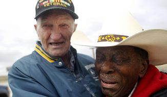 In a Friday, Sept. 29, 2017 photo, Ray Cahoon, left, laughs and sobs, while clutching his long-lost friend from the U.S. Air Force, Roy Salmon, of Melbourne, Fla., after meeting face-to-face on the Wyoming-Colorado border for the first time in more than 50 years. Salmon and Cahoon lost each other in 1957 after Cahoon was transferred to another location, and the two have sought each other out ever since. (Jacob Byk/The Wyoming Tribune Eagle via AP)