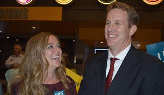 Albuquerque City Council Dan Lewis and his wife, Tracy, speak to a supporter Tuesday, Oct. 3, 2017, in Albuquerque while waiting for election returns for the Albuquerque mayor's race. Unofficial results show Lewis, a Republican, and New Mexico State Auditor Tim Keller, a Democrat, won the top two spots Tuesday in Albuquerque's mayoral race. Both will face each other in a Nov. 14 runoff. (AP Photo/Russell Contreras)