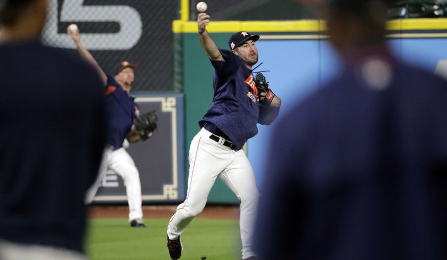 Houston Astros pitcher Justin Verlander throws during practice for baseball's American League Division Series, Wednesday, Oct. 4, 2017, in Houston. Verlander is set to start Game 1 of the ALDS against the Boston Red Sox on Thursday. (AP Photo/David J. Phillip)