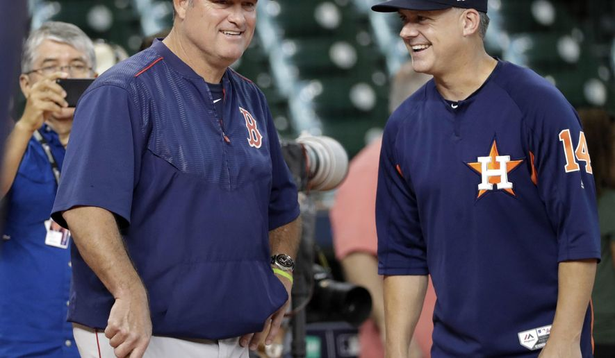 Boston Red Sox manager John Farrell, left, talks with Houston Astros manager A.J. Hinch (14) during practice for baseball's American League Division Series, Wednesday, Oct. 4, 2017, in Houston. The Red Sox will face the Astros Thursday in Game 1 of the ALDS. (AP Photo/David J. Phillip)