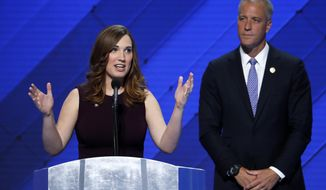 FILE - In this July 28, 2016 file photo, LGBT rights activist Sarah McBride speaks as Rep. Sean Patrick Maloney, D-NY, Co-Chair of the Congressional LGBT Equality Caucus listens during the final day of the Democratic National Convention in Philadelphia. Former vice president Joe Biden is writing the foreword to a memoir by transgender activist McBride, who made history when she addressed the Democratic National Convention last year. (AP Photo/J. Scott Applewhite, File)