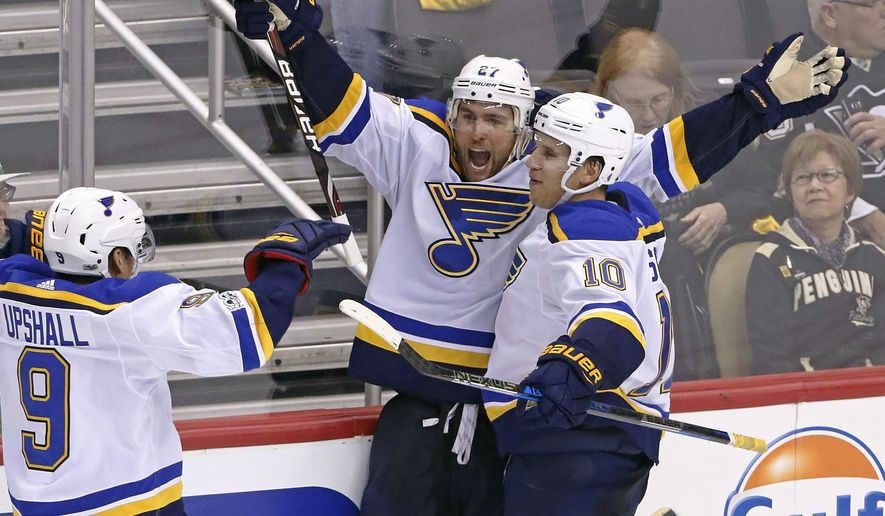 St. Louis Blues' Alex Pietrangelo (27) celebrates his game-winning goal with Brayden Schenn (10) and Scottie Upshall (9) in the overtime period of an NHL hockey game against the Pittsburgh Penguins in Pittsburgh, Wednesday, Oct. 4, 2017. The Blues won 5-4. (AP Photo/Gene J. Puskar)