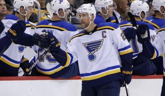 St. Louis Blues' Alex Pietrangelo (27) celebrates his goal as he returns to the bench in the second period of an NHL hockey game against the Pittsburgh Penguins in Pittsburgh, Wednesday, Oct. 4, 2017. (AP Photo/Gene J. Puskar)