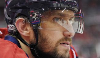 FILE - In this March 14, 2017, file photo, Washington Capitals left wing Alex Ovechkin (8), of Russia, looks on from the bench during the first period of an NHL hockey game against the Minnesota Wild in Washington. Ovechkin is the NHL's best goal-scorer of this generation, but at age 32 what's a realistic expectation? The Capitals still think he can score 50, or at least more than his 33 last year (AP Photo/Nick Wass, File)