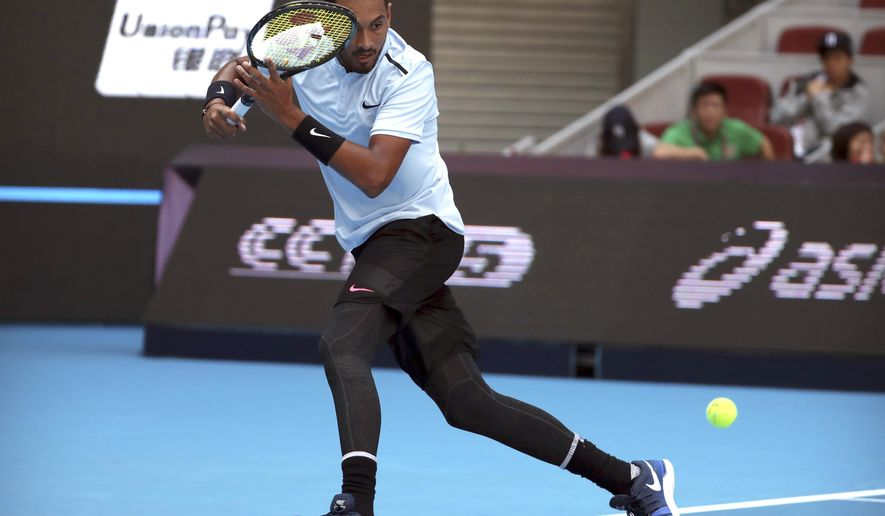Nick Kyrgios of Australia returns a shot against Mischa Zverev of Germany during their men's singles match in the China Open tennis tournament at the Diamond Court in Beijing, Wednesday, Oct. 4, 2017. (AP Photo/Mark Schiefelbein)