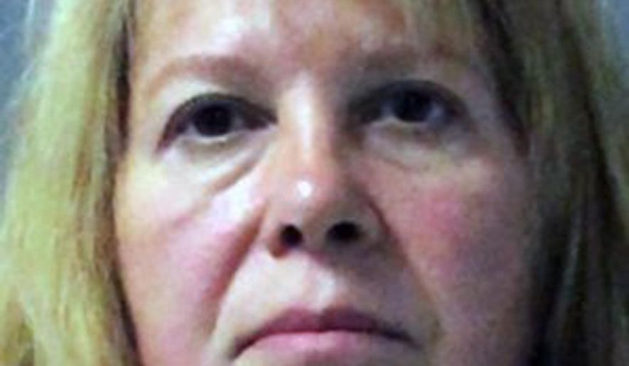FILE - This file photo provided by the Palm Beach County Sheriff's office shows Sheila Keen Warren, who was arrested Tuesday, Sept. 26, 2017, in Abington, Va. Prosecutors said they will seek the death penalty against Warren, who was accused of dressing up like a clown in 1990 and fatally shooting the wife of her future husband. (Palm Beach County Sheriff's office/Palm Beach Post via AP, File)