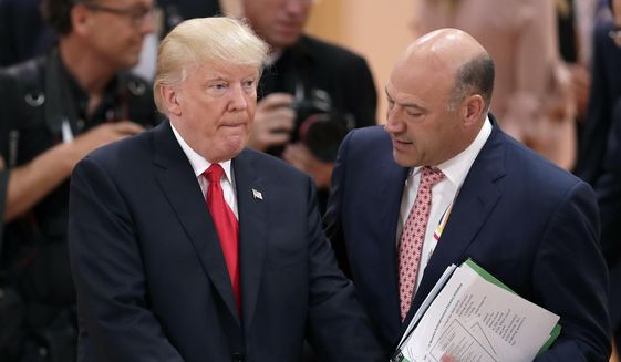 In this Saturday, July 8, 2017, file photo, White House chief economic adviser Gary Cohn, right, talks to U.S. President Donald Trump prior to a working session at the G-20 summit in Hamburg, Germany. (AP Photo/Michael Sohn, File)