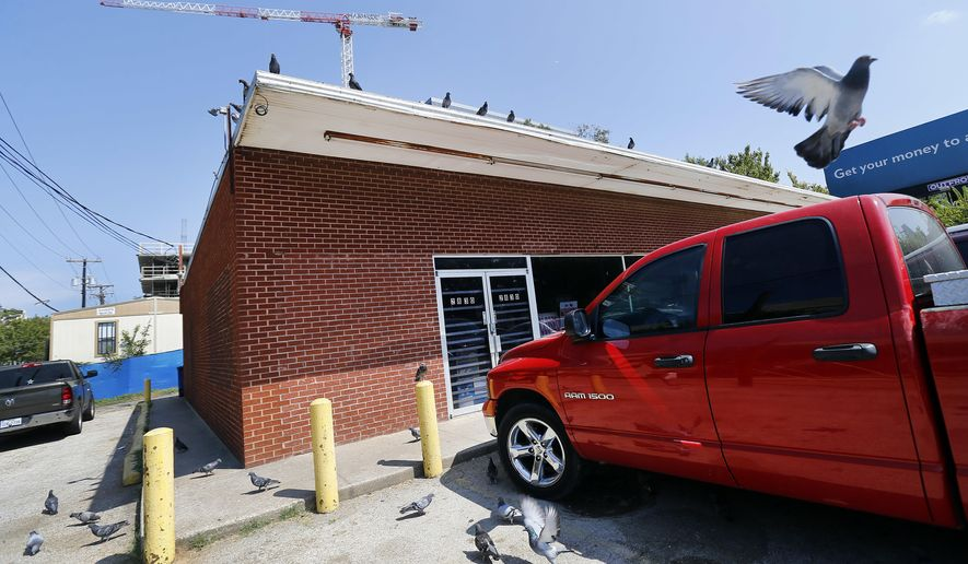 A truck is parked in front of the  Villasana Food Store owned by Charlie Villasana in the Little Mexico section of Dallas on Sept. 20, 2017.   Villasana, a longtime Little Mexico resident, has put off selling his more than $1.5 million dollars worth of property in the area. He is nearly 88 years old and struggles with deciding what to do with the store he grew up in and loves in Dallas.   (Tom Fox/The Dallas Morning News via AP)