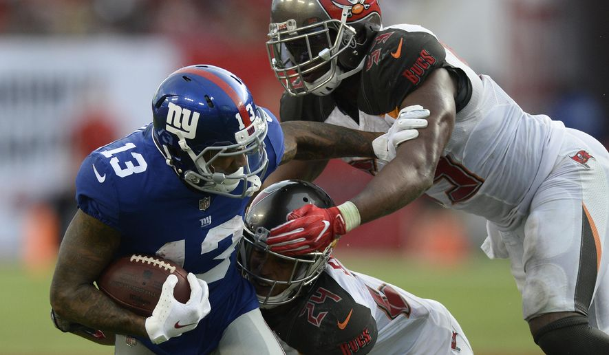New York Giants wide receiver Odell Beckham (13) is stopped by Tampa Bay Buccaneers cornerback Brent Grimes (24) and outside linebacker Adarius Glanton after a reception during the fourth quarter of an NFL football game Sunday, Oct. 1, 2017, in Tampa, Fla. (AP Photo/Jason Behnken) ** FILE **