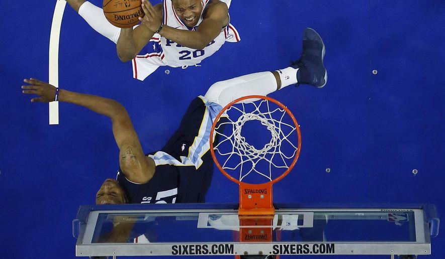 Philadelphia 76ers' Markelle Fultz, top, goes up for a shot against Memphis Grizzlies' Deyonta Davis during the first half of a preseason NBA basketball game, Wednesday, Oct. 4, 2017, in Philadelphia. (AP Photo/Matt Slocum)