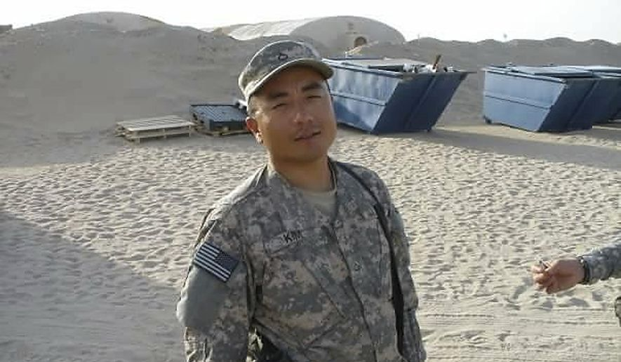 FILE - In this undated file photograph courtesy of Chong Kim provided by his attorney Tim Warden-Hertz, Chong Kim poses for a photo in National Guard fatigues. An immigrant rights group is asking the U.S. Department of Homeland Security to release an Iraq War veteran who has been detained for more than three months while waiting to learn whether he'll be deported. Chong Kim, a South Korean immigrant and green card holder from Portland, Oregon, joined the National Guard in 2005 and served in Iraq in 2009 and 2010. Kim has a parole hearing Wednesday, Oct. 4, 2017. (Chong Kim via AP, File)