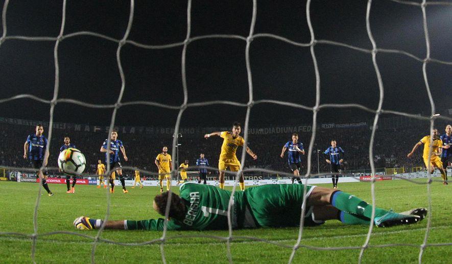 Atalanta goalkeeper Etrit Berisha saves a penalty kicked by Juventus' Paulo Dybala during the Serie A soccer match between Atalanta and Juventus, in Bergamo, Italy, Sunday, Oct. 1, 2017. The match ended in a 2-2 draw. (Paolo Magni/ANSA via AP)