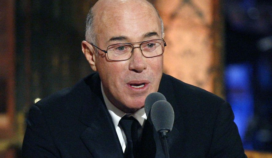 This March 15, 2010, file photo shows music and movie mogul David Geffen speaking during the Rock and Roll Hall of Fame induction ceremony in New York. (AP Photo/Jason DeCrow, file)