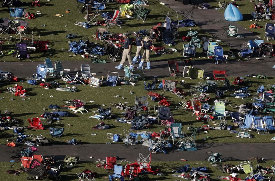 Agents from the FBI continue to process evidence at the scene of a mass shooting on Wednesday, Oct. 4, 2017, in Las Vegas. Stephen Paddock opened fire on an outdoor music concert on Sunday killing dozens and injuring hundreds. (AP Photo/Gregory Bull)