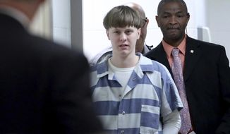 In this Monday, April 10, 2017, file photo, Dylann Roof enters the court room at the Charleston County Judicial Center to enter his guilty plea on murder charges in Charleston, S.C. Roof was given nine consecutive life sentences in state prison after he pleaded guilty to state murder charges. (Grace Beahm/The Post And Courier via AP, Pool, File)