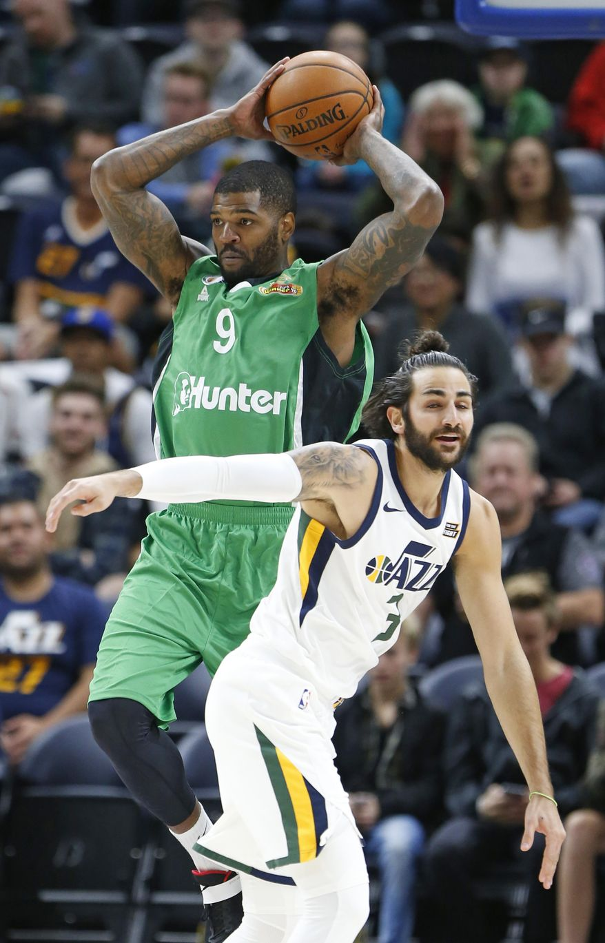 Maccabi Haifa center Josh Smith (9) passes the ball as Utah Jazz guard Ricky Rubio (3) defends during the first half of a preseason NBA basketball game Wednesday, Oct. 4, 2017, in Salt Lake City. (AP Photo/Rick Bowmer)