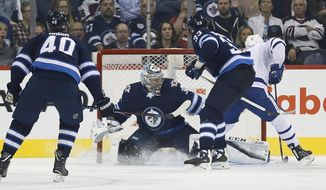 Toronto Maple Leafs' Patrick Marleau (12) scores on Winnipeg Jets goaltender Steve Mason (35) as Joel Armia (40) and Dustin Byfuglien (33) defend during the second period of an NHL hockey game, Wednesday, Oct. 4, 2017 in Winnipeg, Manitoba. (John Woods/The Canadian Press via AP)