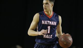 FILE - In this March 4, 2017, file photo, Nathan Hale forward Michael Porter Jr. dribbles downcourt against Garfield in the first half of the Washington state boys 3A high school basketball championship in Tacoma, Wash.  Missouri basketball has been mired in Southeastern Conference irrelevance in recent years under former coach Kim Anderson. No more for the resurgent Tigers, who have national-championship hopes following the hiring of coach Cuonzo Martin after last season and the signing of a Kentucky-like group of freshmen _ highlighted by forward Michael Porter Jr. (AP Photo/Ted S. Warren, File)