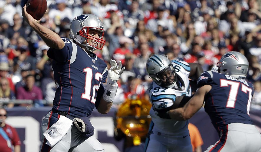 FILE - In this Sunday, Oct. 1, 2017, file photo, New England Patriots quarterback Tom Brady (12) passes under pressure from Carolina Panthers defensive end Mario Addison, center, who is blocked by Patriots tackle Nate Solder (77) during the first half of an NFL football game in Foxborough, Mass. Jameis Winston is excited about the next challenge in the maturation of the young Tampa Bay Buccaneers, a prime-time test against Tom Brady and the defending Super Bowl champion New England Patriots. (AP Photo/Steven Senne, File)