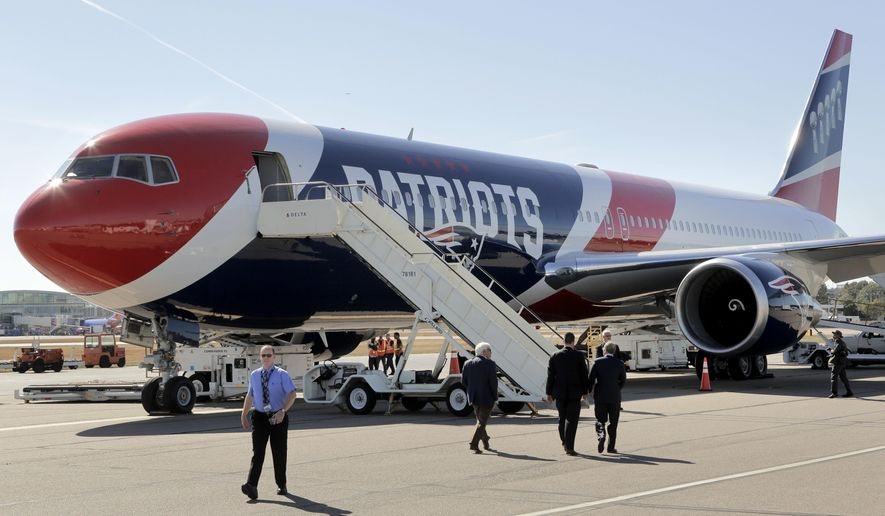 The New England Patriots customized Boeing 767 passenger jet sits on the tarmac, Wednesday, Oct. 4, 2017, at T.F. Green Airport, in Warwick, R.I. The NFL football team are to fly in the aircraft, which is painted with the team's logo and red-white-and-blue colors, and includes the Pats' five Lombardi trophies painted on the tail, on their way to Florida, where they play the Tampa Bay Buccaneers on Thursday, Oct. 5. (AP Photo/Steven Senne)