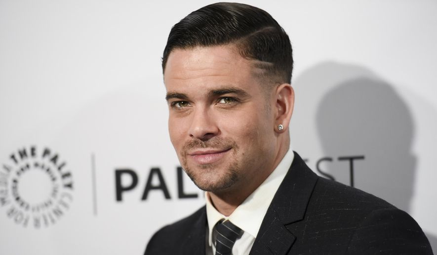 """In this March 13, 2015, file photo, Mark Salling arrives at the 32nd annual Paleyfest """"Glee"""" held at The Dolby Theatre in Los Angeles. (Photo by Richard Shotwell/Invision/AP, File)"""