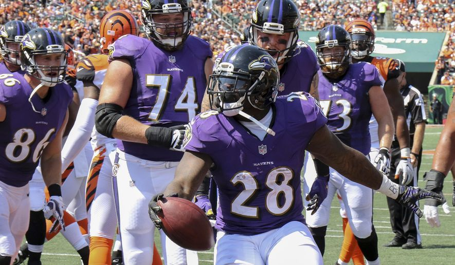 FILE - In this Sept. 10, 2017, file photo, Baltimore Ravens running back Terrance West (28) celebrates after scoring a touchdown in the first half of an NFL football game against the Cincinnati Bengals in Cincinnati. (AP Photo/Gary Landers, File)