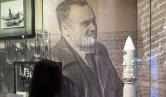 In this photo made on Monday, Oct. 2, 2017 a photo of Sergei Korolyov, the father of the Soviet space program is on display at the Museum of Cosmonautics in Moscow, Russia. The launch of Sputnik 60 years ago opened the space era and became a major triumph for the Soviet Union, showcasing its military might and technological edge. (AP Photo/Ivan Sekretarev)