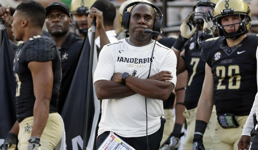 FILE - In this Sept. 23, 2017, file photo, Vanderbilt head coach Derek Mason watches from the sideline in the second half of a 59-0 loss to Alabama in an NCAA college football game in Nashville, Tenn. Six SEC teams, LSU, Mississippi, Mississippi State, Missouri, Tennessee and Vanderbilt, have already have lost a conference contest by 30 or more points. (AP Photo/Mark Humphrey, File)