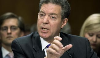 Samuel Brownback, governor of Kansas and a former U.S. senator, appears before the Senate Foreign Relations Committee as the nominee to be the United States Ambassador-at-Large for International Religious Freedom, at the Capitol in Washington, Wednesday, Oct. 4, 2017. (AP Photo/J. Scott Applewhite)