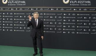 """FILE - In this Oct. 2, 2017 file photo French-Polish film director Roman Polanski poses on the Green Carpet before the screening of """"Based on a True Story - D'apres une histoire vraie"""" at the 13th Zurich Film Festival (ZFF) in Zurich, Switzerland. Swiss authorities said Wednesday, Oct. 4, 2017 they have received a complaint from a German woman alleging that famed filmmaker Roman Polanski raped her 45 years ago in Gstaad, Switzerland, while she was in her mid-teens.   (Ennio Leanza/Keystone via AP, file)"""