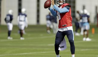 Tennessee Titans quarterback Marcus Mariota (8) throws during NFL football practice Wednesday, Oct. 4, 2017 in Nashville, Tenn. Mariota suffered a strained hamstring Sunday while playing against the Houston Texans. (AP Photo/Mark Humphrey)