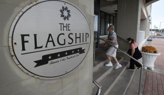 In a photo taken Wednesday, Sept. 27, 2017, a couple makes its way into the Flagship Resort in Atlantic City, N.J. The resort offers timeshares space for its guests. (AP Photo/Julio Cortez)