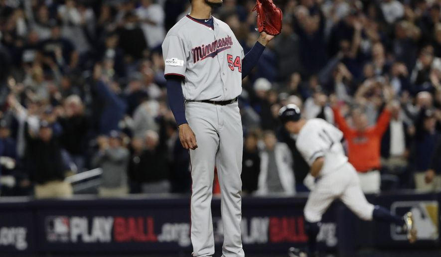 Minnesota Twins starting pitcher Ervin Santana waits as New York Yankees' Brett Gardner (11) runs the bases after hitting a home run during the second inning of the American League wild-card baseball game Tuesday, Oct. 3, 2017, in New York. (AP Photo/Frank Franklin II)