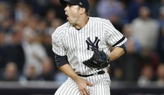 New York Yankees relief pitcher David Robertson reacts after Yankees catcher Gary Sanchez was hit by a foul tip of during the sixth inning an American League wild-card playoff baseball game against the Minnesota Twins in New York, Tuesday, Oct. 3, 2017. (AP Photo/Kathy Willens)