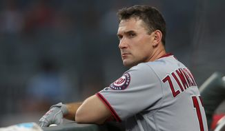 Washington Nationals first baseman Ryan Zimmerman (11) is shown before the first inning of a baseball game against the Atlanta Braves Wednesday, Sept. 20, 2017, in Atlanta. (AP Photo/John Bazemore)