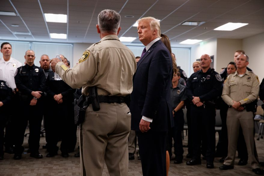 President Donald Trump listens to Clark County Sheriff Joseph Lombardo during a meeting with first responders at the Las Vegas Metropolitan Police Department, Wednesday, Oct. 4, 2017, in Las Vegas. Associated Press photo