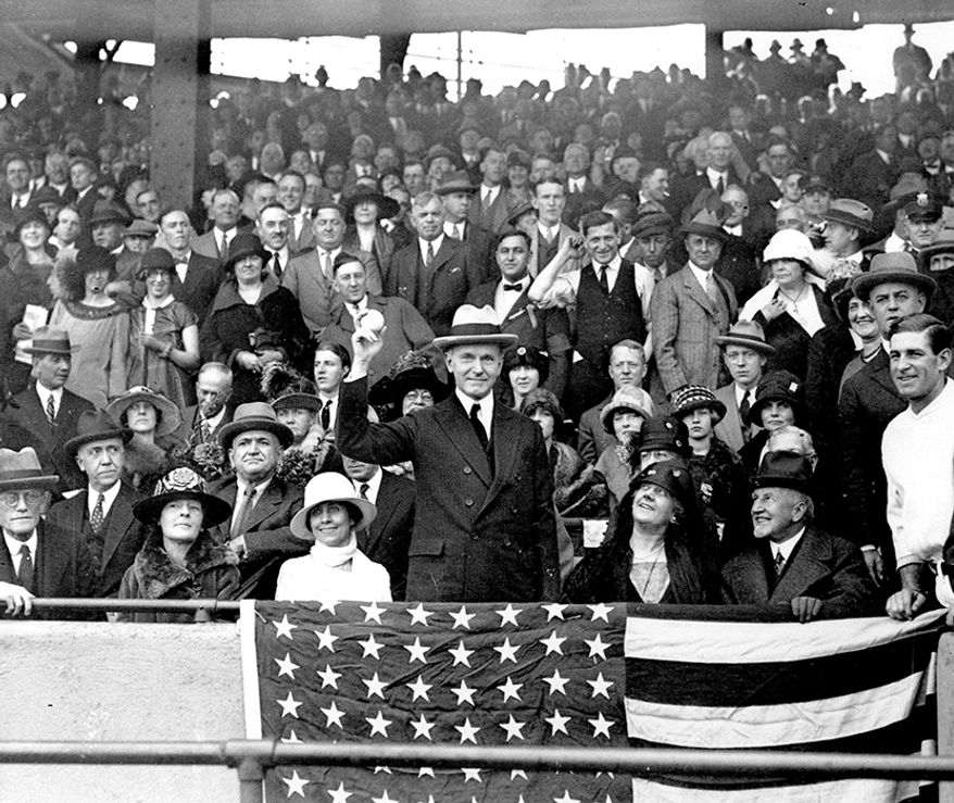 5. Washington Senators vs. New York Giants: 1924 World Series - Washington Senators won in 7 games  In this Oct. 4, 1924, file photo, U.S. President Calvin Coolidge throws out the ball for the opening game of the 1924 World Series between the Washington Senators and the New York Giants in Washington. The Senators stormed to the top of the league the year after a losing season, had a star pitcher who was the subject of intense national discussion, and won praise from Coolidge for their performance. (AP Photo/File)